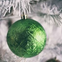 Noël - green bauble on a white tree.